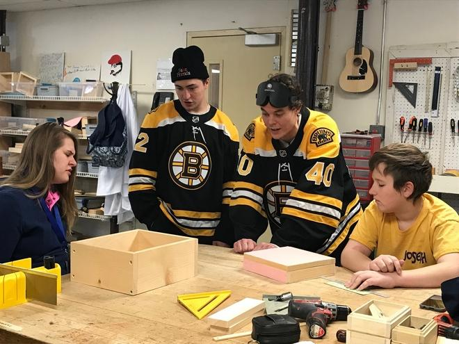 Two elite Boston Bruins players were shown up by amateur fencers at the Carroll Center for the Blind Wednesday, during the players' visit.