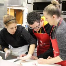 As part of the CarrollPrep weekend program, a young visually impaired teen learns knife cutting skills in a commercial kitchen as he discovers different culinary careers.
