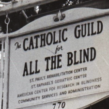 "A black and white photo of the original sign at the foot of the Center's driveway reading, ""Catholic Guild for All The Blind."""