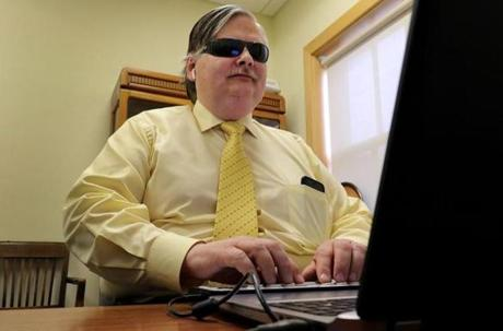 Brian Charlson, who was blinded at age 11, typed on a Braille keyboard in his office at the Carroll Center for the Blind in Newton.