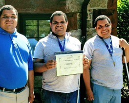 Blind triplets smile together outside their dormitory after completing their Independent Living Programs.