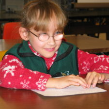 A young visually impaired girl in the newly-created CarrollKids summer program practices her braille.