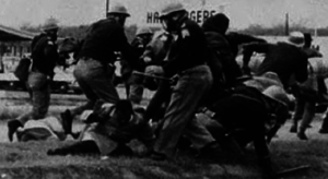 Alabama State Troopers attack John Lewis at the Edmund Pettus Bridge.