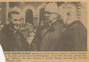 Newspaper clipping showing Father Carroll and two other clergy members gathered at Selma.