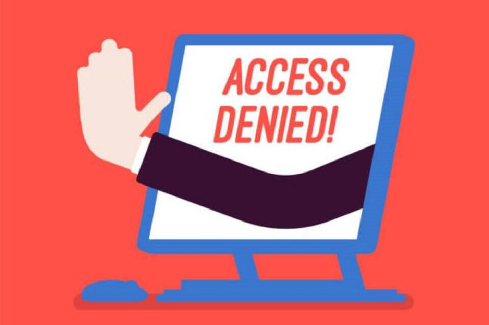 "A cartoon hand pokes out from a computer monitor with the words ""Access Denied"" on the screen. This illustrates the effects of inaccessible technology on those whom it excludes."