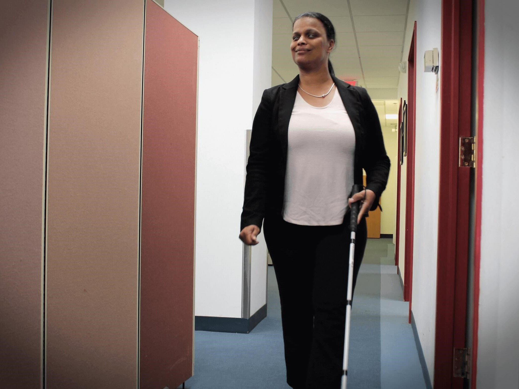 Daniela Depina, a 2019 Carroll Society Award inductee, walks down a hallway to her office at Boston Council for Independent Living.