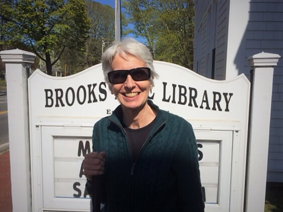 Carla Burke, the 2019 Blind Employee of the Year, smiles outside of the Brooks Free Library in Harwich, MA.