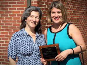 Kate Katulak smiles with her nominating supervisor at the 2019 Carroll Society Awards she was recognized at.