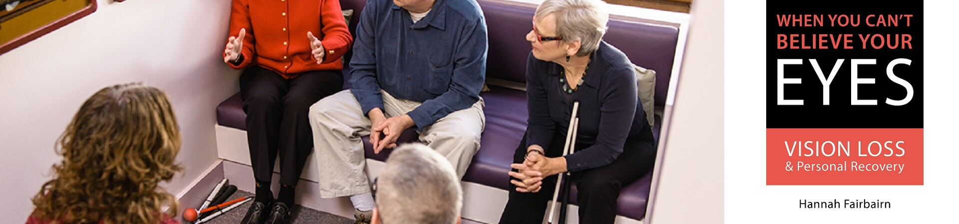 """Hannah Fairbairn, author of """"When You Can't Believe Your Eyes,"""" sits with a group of four adults with vision loss at the Carroll Center."""