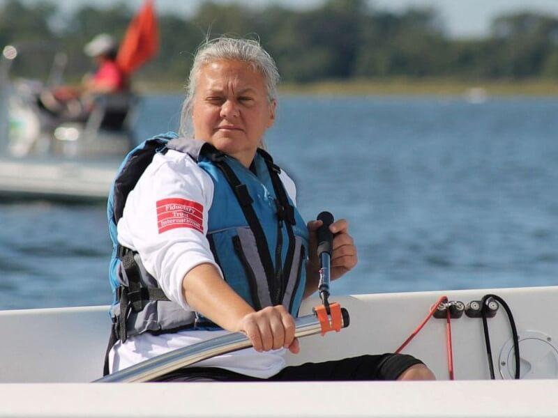 Pauline Dowell steers a sailboat.