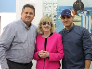 From left to right; Gregory J. Donnelly, President and CEO of the Carroll Center for the Blind; Maura Mazzocca, Personal Management Instructor at the Carroll Center for the Blind; Alex Iliades, Owner of Farm Grill & Rotisserie.