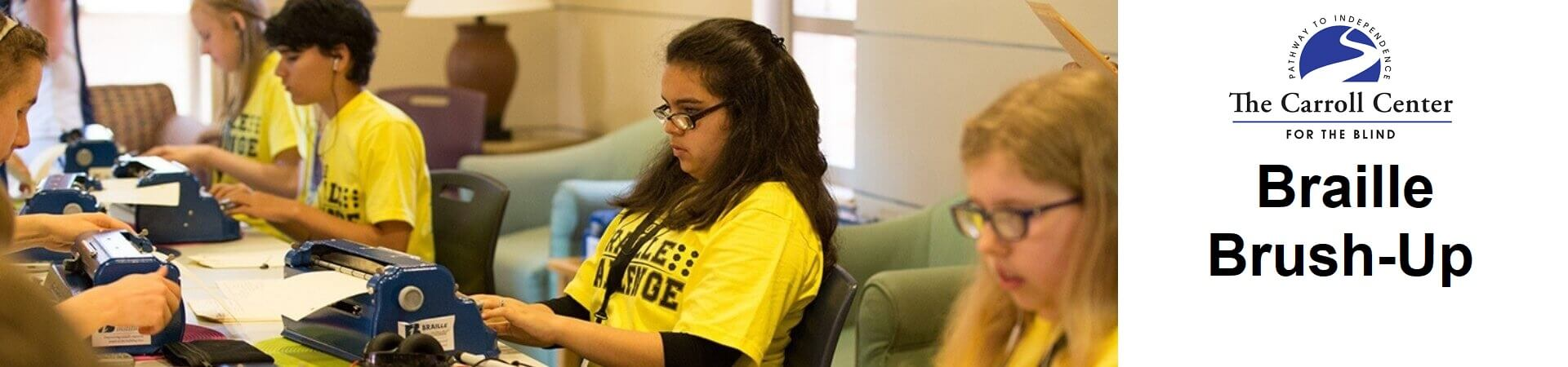 "A group of five students wearing yellow ""Braille Challenge"" shirts practice on their braillers."