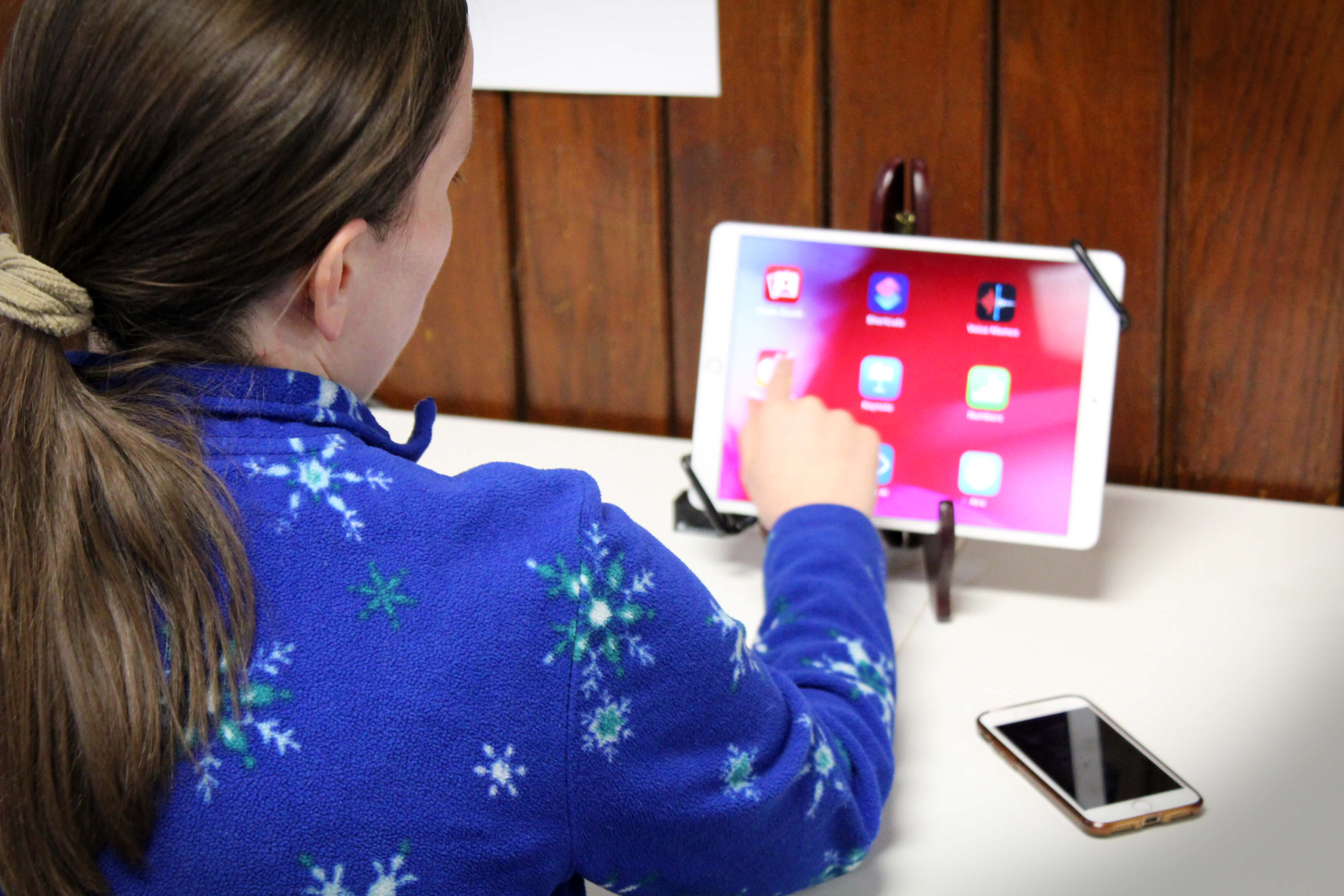 A woman explores the built-in magnifier on an iPad at the Carroll Center's assistive device lab.