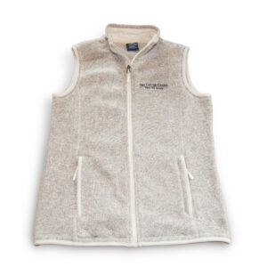 Heather Oatmeal colored fleece vest. On the left breast pocket is the Carroll Center for the Blind logo in black stitching.