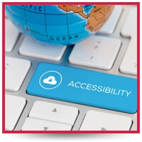 """On a computer keyboard with white keys is a blue button that reads, """"Accessibility."""" A miniature globe rests on top of the keyboard."""